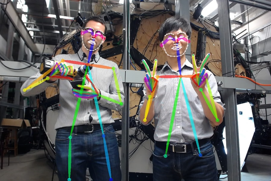 Image of two robotics institute researchers showing how gestures are detected