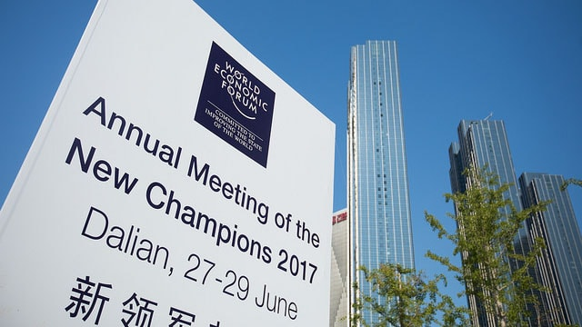 Image of the World Economic Forum sign in Dalian China
